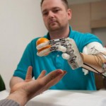 Restoring Natural Sensory Feedback in Real-Time Hand Prostheses